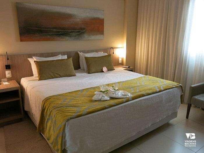 Cama do quarto no Quality Hotel Pampulha